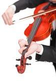 Tiro vertical del violinista que toca un violín Fotografía de archivo