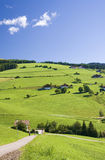 Tirol Hills blue sky. Green grass tirol hills and a bright blue sky Stock Photos