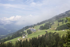 Tirolean Alps Hohe Salve. The alps in tirol, green meadows, blue skies and mountains covered with clouds Stock Photos
