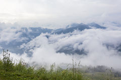 Tirolean Alps. The alps in tirol, green meadows, blue skies and mountains covered with clouds Royalty Free Stock Photos