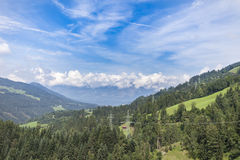 Tirolean Alps. The alps in tirol, green meadows, blue skies and mountains covered with clouds Stock Photos