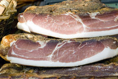 Tirolean speck hum. Cold cuts of speck in a tirolean market stock image
