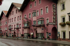 Tirolean street with pink houses. Matrei am Brenner; Austria Stock Photography