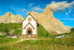 Tirolian chapel,car and high mountains,Dolomites,Italy,Europe. Chapel and mountains,Cimon Della Pala in background,Dolomites,Sudtirol,Italy,Europe royalty free stock photo