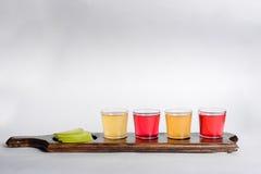 Tiros coloridos com álcool diferente Fotografia de Stock