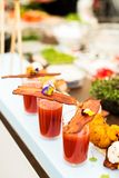 Tiros do Bloody Mary com bacon friável Fotografia de Stock Royalty Free