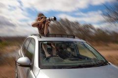 Tiros loucos do fotógrafo como conduzindo Imagens de Stock Royalty Free