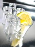 Tiros vacíos con el limón Imagen de archivo libre de regalías