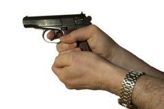 Tiroteo de la pistola de Makarov con ambas manos Fotos de archivo libres de regalías