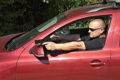 Tiroteo del asesino de un coche móvil Imágenes de archivo libres de regalías
