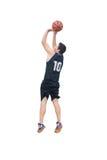 Tiroteo del jugador de básquet en blanco Foto de archivo