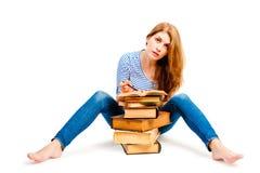 Tiroteo en estudiante del estudio con los libros Imagen de archivo libre de regalías