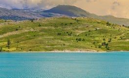 Tirquoise Klinje lake. Beautiful tirquoise lake Klinje, Bosnia and Herzegovina, with the mountains Royalty Free Stock Image