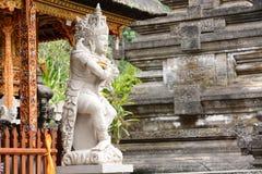 A statue of a deity. Tirta Empul. Tampaksiring. Gianyar regency. Bali. Indonesia royalty free stock photography