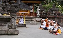Devotees in the inner yard. Tirta Empul. Tampaksiring. Gianyar regency. Bali. Indonesia royalty free stock photography