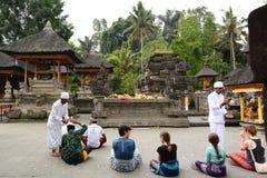 Visitors in the inner yard. Tirta Empul. Tampaksiring. Gianyar regency. Bali. Indonesia royalty free stock images