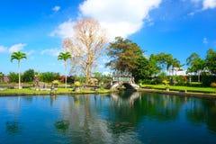 Tirta Gangga bevattnar slotten bali indonesia royaltyfria bilder