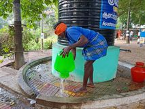 Tiruvanamalai, India - December 20, 2018: Sadhu cleaning pots in Tiruvanamalai India. Asia royalty free stock photography