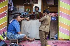 Indian taylor working on the street. Tiruvannamalai in Tamil Nadu, India, January 31, 2018: Indian taylor working on the street stock photo