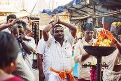 People praying in front of the Tiruvannamalai temple. Tiruvannamalai in Tamil Nadu, India, January 31, 2018: People praying in front of the Tiruvannamalai temple stock image