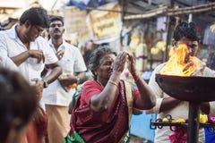People praying in front of the Tiruvannamalai temple. Tiruvannamalai in Tamil Nadu, India, January 31, 2018: People praying in front of the Tiruvannamalai temple stock photo