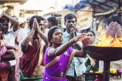 People praying in front of the Tiruvannamalai temple. Tiruvannamalai in Tamil Nadu, India, January 31, 2018: People praying in front of the Tiruvannamalai temple royalty free stock photo
