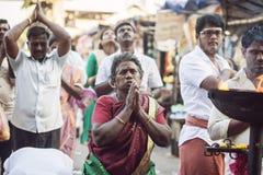 People praying in front of the Tiruvannamalai temple. Tiruvannamalai in Tamil Nadu, India, January 31, 2018: People praying in front of the Tiruvannamalai temple stock photos