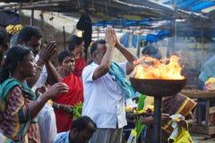 People praying in front of the Tiruvannamalai temple. Tiruvannamalai in Tamil Nadu, India, January 31, 2018: People praying in front of the Tiruvannamalai temple royalty free stock images