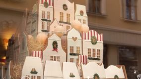 Tis the season for the gingerbread house. shop window. Tis the season for the gingerbread house, old town stock video footage
