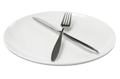 Tischbesteck auf leerer Platte Lizenzfreies Stockbild
