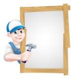 Tischler Holding Hammer Sign Stockbilder