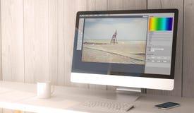 Tischrechnerfoto redigieren Stockfotografie