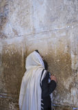Tisha B'av. JERUSALEM - JULY 29 : Jewish man prays in the Wailing wall during the Jewish holyday of Tisha B'av , on July 29 2012 in old Jerusalem , Israel Royalty Free Stock Photography