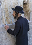 Tisha B'av. JERUSALEM - JULY 29 : Jewish man prays in the Wailing wall during the Jewish holyday of Tisha B'av , on July 29 2012 in old Jerusalem , Israel Royalty Free Stock Photos