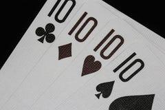Tisonnier de casino de dix jouant des cartes Photo libre de droits