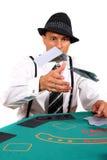 Tisonnier jouant jetant des cartes en l'air Photos stock