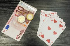 Tisonnier - pièces de monnaie de flux droit, d'argent et d'euro Photographie stock libre de droits