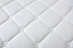 Tissu élégant blanc avec des molettes Images libres de droits