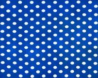 Tissu avec des points de polka Images stock