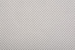 Tissu beige avec des points, un fond. Photos libres de droits