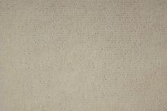 Tissu beige de texture sous la toile Image stock