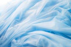 Tissu bleu élégant lisse images stock