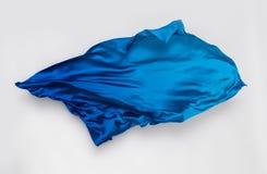 Tissu bleu abstrait dans le mouvement photos libres de droits