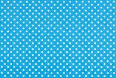 Tissu bleu avec les points de polka blancs Photo stock