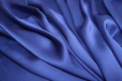 tissu bleu de satin Photographie stock libre de droits