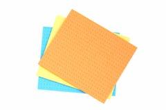 Tissu bleu, jaune et orange pour le nettoyage. Images libres de droits
