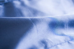 Tissu bleu mou de satin Images libres de droits