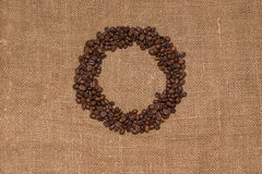 Tissu brun de toile de jute de grains de café naturel Photo stock