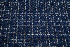 Tissu chaud bleu-foncé dans une cage Photos libres de droits