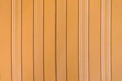Tissu de Brown avec les rayures verticales comme fond ou texture images libres de droits